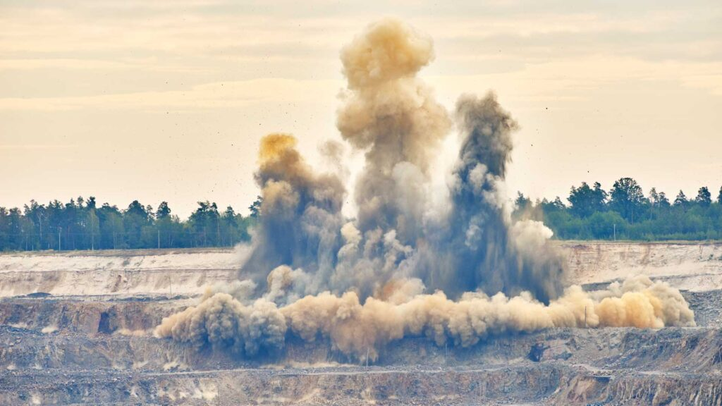Picture of an explosion at an aggregate mining operation.
