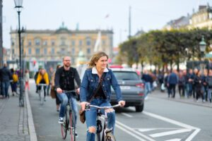 Picture of woman on a bike. Credit Kristoffer Trolle.