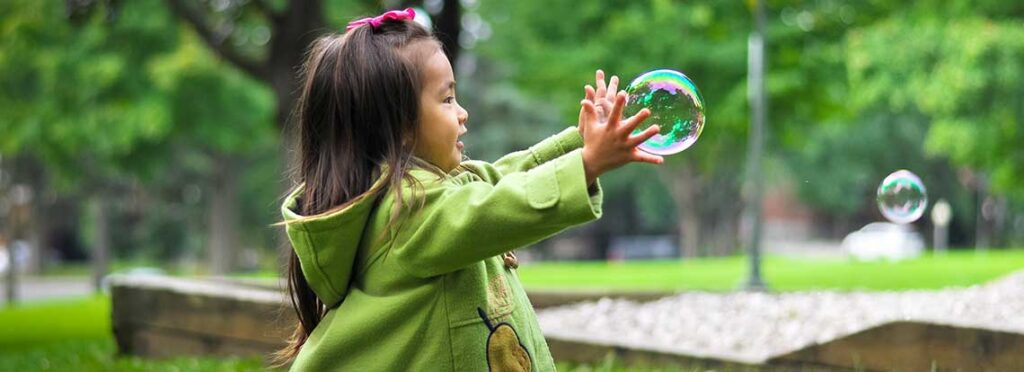 Young girl with a bubble. Credit Leo Rivas.