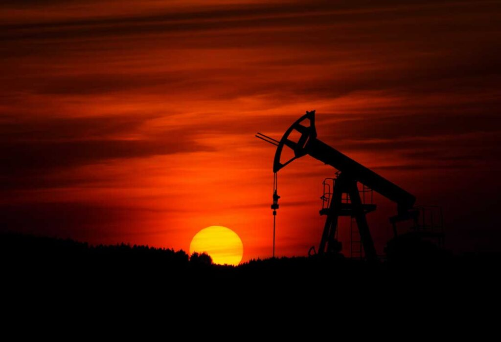 Picture of an oil drill with a red sunset behind it. Credit Zbynek Burival.