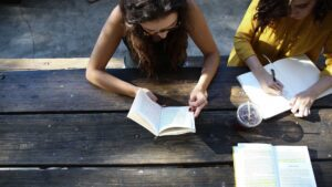 A photo showing two young women studying books, taken from above. Credit Alexis Brown.