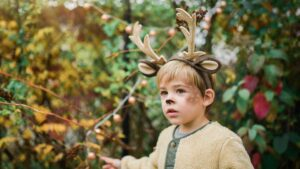 Photo of a child dressed up as a deer for halloween. Credit Paige Cody.