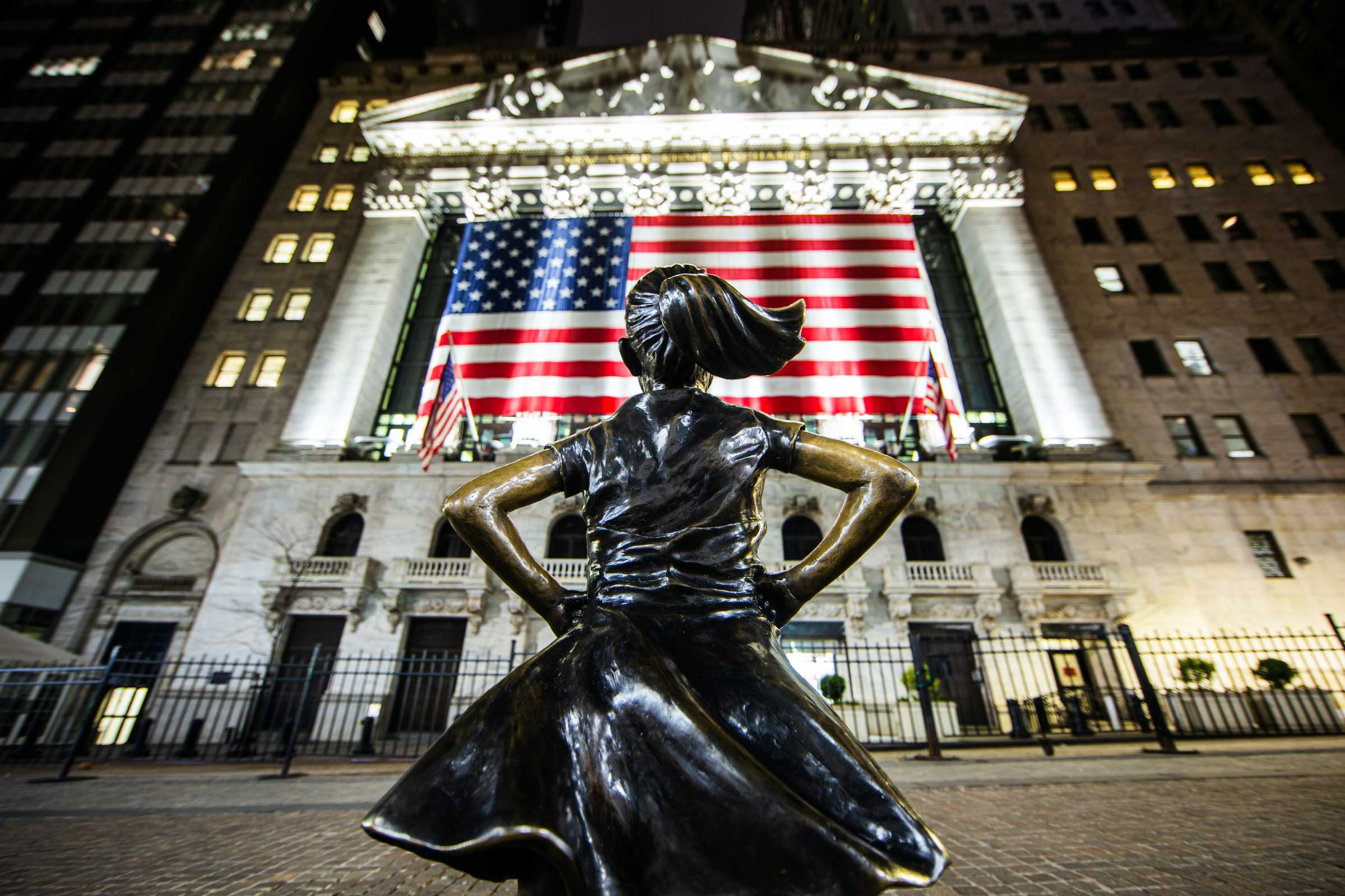 Photo of the Fearless Girl statue on Wall Street, with the NYSE in front of her. Photo by Ahmer Kalam